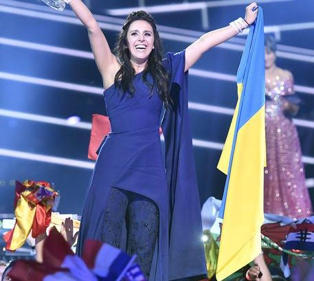 Ukraine's Jamala celebrates with the trophy after winning the Eurovision Song Contest final with the song '1944' in Stockholm, Sweden, Sunday, May 15, 2016. (ANSA/AP Photo/Martin Meissner)