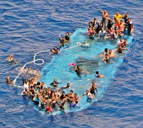 epa05330258 A handout picture released by the European Union Naval Force - Mediterranean (Eunavformed) on 26 May 2016 shows people in stress on their overturned boat in Canal of Sicily off the Libyan coast, 25 May 2016. The Italian navy said it had recovered five bodies from the overturned migrant ship. Over 550 migrants on board were rescued safely.  EPA/EUNAVFOR MED OHQ / HANDOUT  HANDOUT EDITORIAL USE ONLY/NO SALES